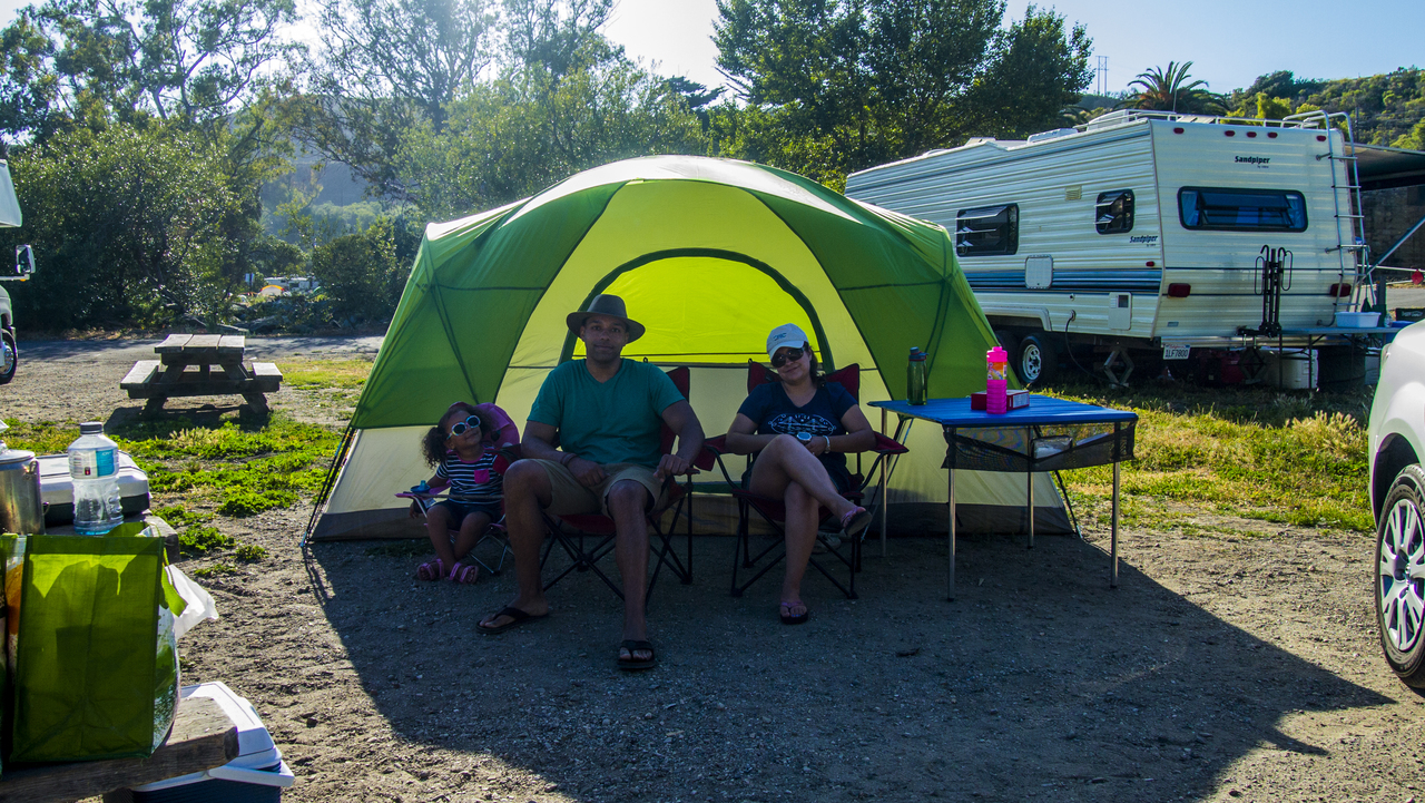 Senior man and his wife spending weekend camping by the river high